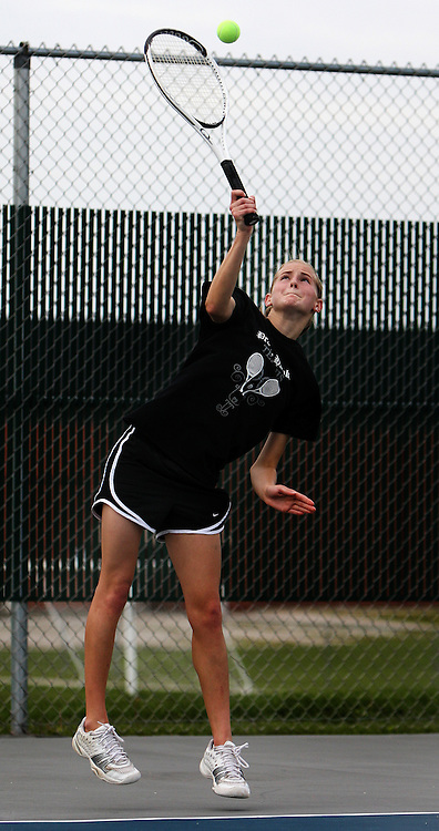 Prairie's Caroline Rainey, junior, serves the ball to Xavier's Elizabeth Hoffmann (not pictured) during their match in the 1st round of the Regional Tennis Tournament at Xavier High School in Cedar Rapids on Saturday, May 15, 2010. Hoffmann defeated Rainey 6-0, 6-0 and Xavier defeated Prairie 5-0.