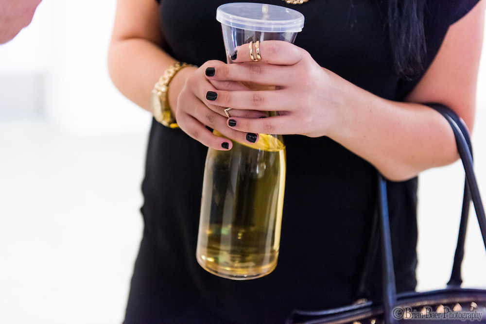 Adara Munoz, holds a carafe of wine inside Golden One Center, Monday Oct 10, 2016.<br /> photo by Brian Baer