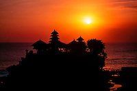 Bali, Tabanan, Tanah Lot. The Tanah Lot rock is the home of a pilgrimage temple, the Pura Tanah Lot. The sunsets here are famous.