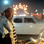 A young boy selling peanuts (in the hope of plum earnings overnight) at one of the largest confluence of humans at the Maha Kumbh Mela at Allahabad, 2001