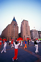 Early morning exercisers in Huangpu Park (The Bund in background), Shanghai, China