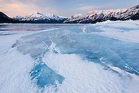 Daybreak over the wind blasted surface of Abraham Lake, Alberta Canada