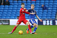 Joe Ralls of Cardiff city ® challenges Tom Lawrence of Blackburn Rovers. Skybet football league championship match, Cardiff city v Blackburn Rovers at the Cardiff city stadium in Cardiff, South Wales on Saturday 2nd Jan 2016.<br /> pic by Andrew Orchard, Andrew Orchard sports photography.