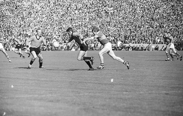 Down's J Murphy has the ball in full flight for the Kerry goalmouth followed by Kerry during the All Ireland Senior Gaelic Football Final Kerry v Down in Croke Park on the 22nd September 1968. Down 2-12 Kerry 1-13.