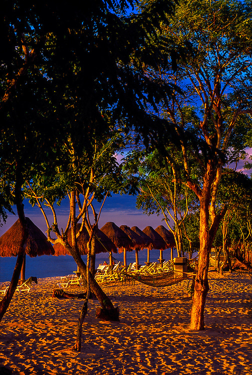 Beach scene with a row of palapas, Isla Cozumel, Mexico