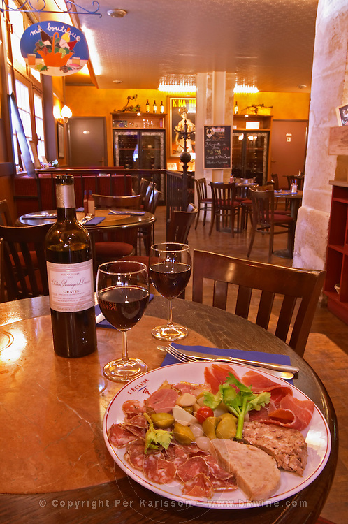 The L'Ecluse wine bar and restaurant in Paris with pate, sausages, ham and wine for two Paris, France.