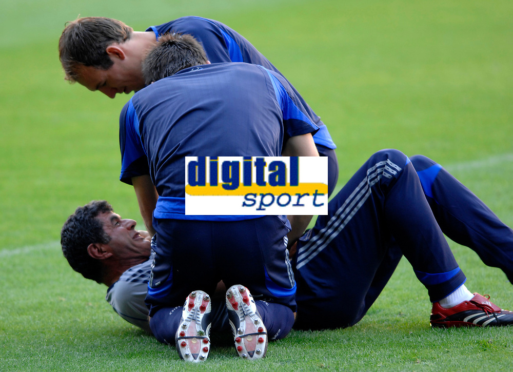 Photo: Richard Lane.<br />Chelsea training session. UEFA Champions League. 30/10/2006. <br />Chelsea assistant manager, Baltemar Brito is pinned down by John Terry and Arjen Robben.