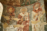 Pictures & Images of the Archangel Georgian Orthodox Church interior Georgian style fresco paintings of saints, 10th - 11th century, Upper Krikhi, Krikhi, Georgia (country). .<br /> <br /> Visit our MEDIEVAL PHOTO COLLECTIONS for more   photos  to download or buy as prints https://funkystock.photoshelter.com/gallery-collection/Medieval-Middle-Ages-Historic-Places-Arcaeological-Sites-Pictures-Images-of/C0000B5ZA54_WD0s<br /> <br /> Visit our REPUBLIC of GEORGIA HISTORIC PLACES PHOTO COLLECTIONS for more photos to browse, download or buy as wall art prints https://funkystock.photoshelter.com/gallery-collection/Pictures-Images-of-Georgia-Country-Historic-Landmark-Places-Museum-Antiquities/C0000c1oD9eVkh9c