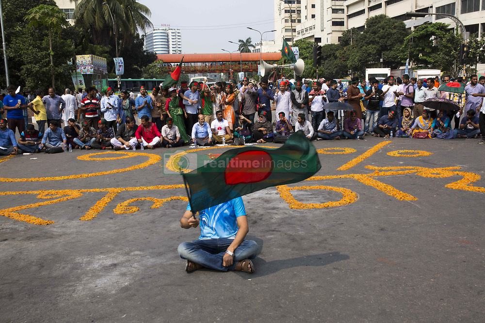 October 4, 2018 - Dhaka, Bangladesh - DHAKA, BANGLADESH - OCTOBER 04 : Protesters shout slogans and block Shahbagh intersection as they demand to reinstate a 30 per cent quota for freedom fighters' children and grandchildren in Dhaka , Bangladesh on October 04, 2018...According to local media reports, the Bandgladeshi cabinet has approved a government committee's decision to abolish the existing quota system for class-I and class-II jobs in the civil service. (Credit Image: © Zakir Hossain Chowdhury/ZUMA Wire)