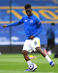 Brighton and Hove Albion's Yves Bissouma warming up prior to kick-off during the Premier League match at the American Express Community Stadium, Brighton. Picture date: Saturday May 15, 2021.