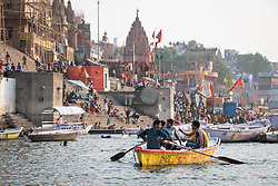May 18, 2019 - Varanasi, India - On the Ganges River, young men on a row boat make their way past the Dashashwamedh Ghat in the city of Varanasi, India, one of Hinduism's most important sites. Photo taken 18 May 2019. (Credit Image: © Diego Cupolo/NurPhoto via ZUMA Press)