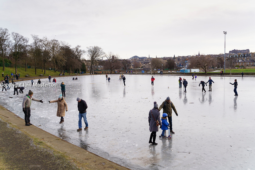Edinburgh, Scotland, UK. 9 January 2020. Members of the public skating and walking on frozen pond in Inverleith Park in Edinburgh today. Near freezing temperatures persist in the city and despite a severe Covid-19 lockdown the park was busy with people walking and exercising.  Iain Masterton/Alamy Live News