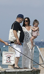 Please Hide The Child's Face Prior To The Publication - American producer Harvey Weinstein and his wife actress/designer Georgina Chapman with their daughter India Pearl leaving the Club 55 during their holiday in Saint-Tropez, French Riviera, southern France on July 7, 2014. Photo by ABACAPRESS.COM  | 456298_002 Saint Tropez France
