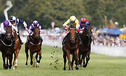 Red Roman ridden by jockey Harry Bentley (yellow silks) coming home to win the Betfred Mobile Nursery race during day four of the Qatar Goodwood Festival at Goodwood Racecourse.