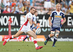 Quade Cooper of the Reds kicks the ball with Schalk Burger on defense during the Super Rugby (Super 15) fixture between DHL Stormers and the Reds played at DHL Newlands in Cape Town, South Africa on 9 April 2011. Photo by Jacques Rossouw/SPORTZPICS