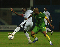 Photo: Tony Oudot.<br /> Ghana v Senegal. International Friendly. 21/08/2007.<br /> Michael Essien of Ghana clashes withHadji El Diouf of Senegal