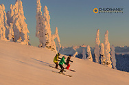 Skiers down the fresh groom at Whitefish Mountain Resort in Whitefish, Montana, USA model released