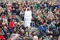 © London News Pictures. 03/04/15. London, UK. Jesus is resurrected during the performance of The Passion of Jesus, Trafalgar Square, central London. Photo credit: Laura Lean/LNP