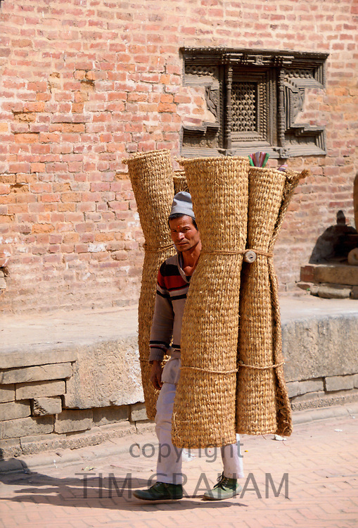 Man carrying home-made mats to market, Bhaktapur, Nepal RESERVED USE - NOT FOR DOWNLOAD -  FOR USE CONTACT TIM GRAHAM