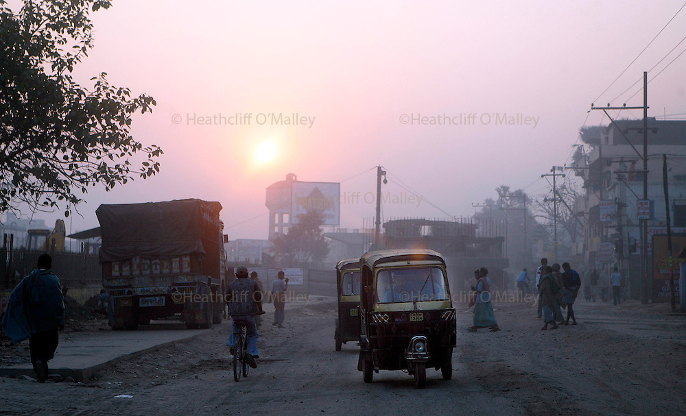 Photo by Heathcliff Omalley..Bihar State, India..Sunrise on the road to Mokama, 90 kms east of Patnar, the capital of Bihar, India's most lawless state.
