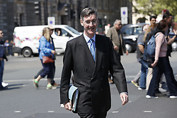 © Licensed to London News Pictures. 13/05/2019. London, UK. Conservative MP Jacob Rees-Mogg walks across Parliament Square as high level talks between the government and Labour resume in an attempt to reach a compromise over Brexit. Photo credit: Peter Macdiarmid/LNP