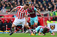 Marko Arnautovic of Stoke battles  for the ball with Havard Nordtveit of West Ham . Premier league match, Stoke City v West Ham Utd at the Bet365 Stadium in Stoke on Trent, Staffs on Saturday 29th April 2017.<br /> pic by Bradley Collyer, Andrew Orchard sports photography.