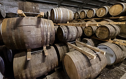 Scotch whisky barrels in warehouse at Edradour Distillery in Pitlochry, Scotland, United Kingdom