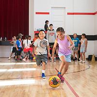 Layondre Peterson, left, and Deiyanera Franklin chase a ball down during a drill Thursday morning at St. Michael  Indian School summer basketball Cardinal Camp in St. Michaels, Arizona.