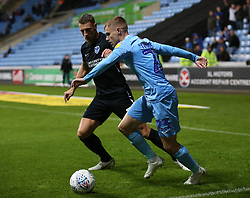 Coventry City's Luke Thomas and Portsmouth's Gary Sawyer battle for the ball
