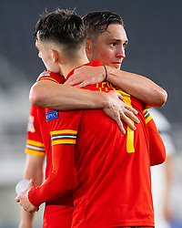 HELSINKI, FINLAND - Thursday, September 3, 2020: Wales' Connor Roberts (R) and Dylan Levitt celebrate at the final whitsle during the UEFA Nations League Group Stage League B Group 4 match between Finland and Wales at the Helsingin Olympiastadion. Wales won 1-0. (Pic by Jussi Eskola/Propaganda)