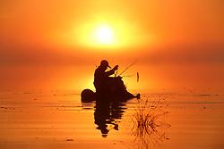 June 16, 2017 - Fishing in the wetland amongst the morning mist along the Wusuli River in northeast China's Heilongjiang Province. (Credit Image: © Xu Congjun/Xinhua via ZUMA Wire)