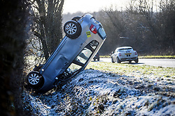 © Licensed to London News Pictures. 30/01/2019. Beaconsfield, UK.  A car which has veered off the road in icy conditions near Beaconsfield, Buckinghamshire, as snow hits the south east of England. Photo credit: Ben Cawthra/LNP