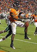 Oct 23, 2010; Charlottesville, VA, USA; Virginia Cavaliers wide receiver Kris Burd (18) drops the ball while being covered by Eastern Michigan Eagles cornerback Arrington Hicks (19) during the 1st half of the game at Scott Stadium.  Mandatory Credit: Andrew Shurtleff