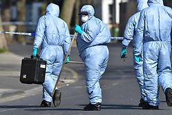 © Licensed to London News Pictures. 27/03/2020.  London UK: Police forensic search teams comb the grounds of the Memorial community church in Barking road, Plaistow, east London after the body of a female in her early forties was found on Thursday afternoon. Detectives have launched a murder investigation after the woman was pronounced dead at the scene  , Photo credit: Steve Poston/LNP