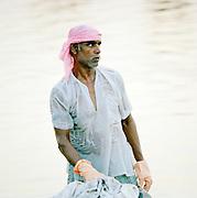 Man washing clothes in the Gomti River, Lucknow, Uttar Pradesh, India