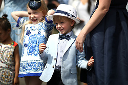 A young racegoer during ladies day of the 2018 Investec Derby Festival at Epsom Downs Racecourse, Epsom.
