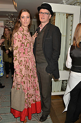 SOPHIA ROGGE and her husband TARQUIN PACK at the launch of Mrs Alice in Her Palace - a fashion retail website, held at Fortnum & Mason, Piccadilly, London on 27th March 2014.