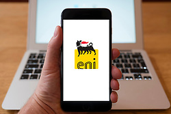 Using iPhone smartphone to display logo of Eni oil and gas company from Italy