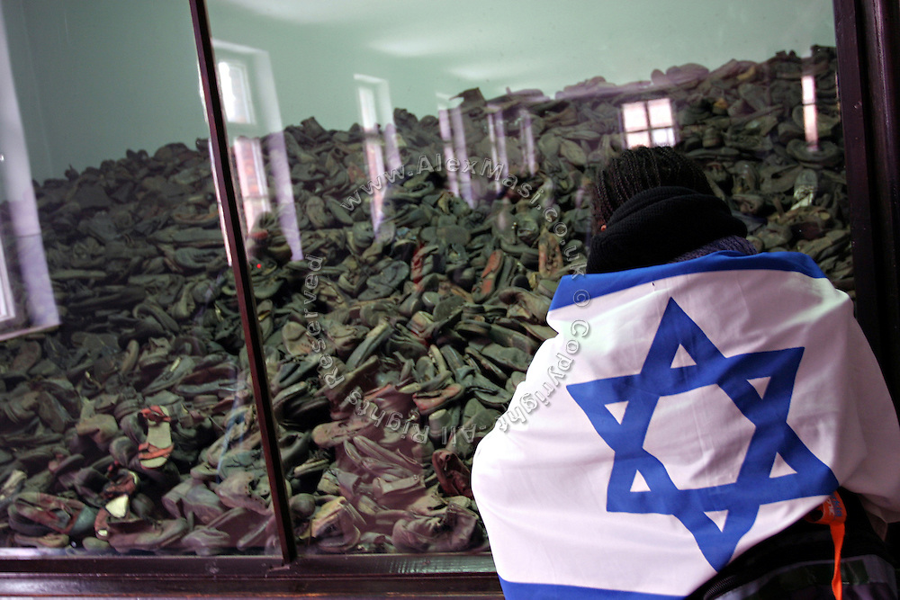 Auschwitz Concentration Camp museum. Man with an Israeli flag looking at the shoes left by the genocide, on Sunday, Apr. 16, 2006. **ITALY OUT**