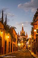 Looking down the cobllestones of Aldama Street to the Parish of San Miguel in San Miguel de Allende, Mexico