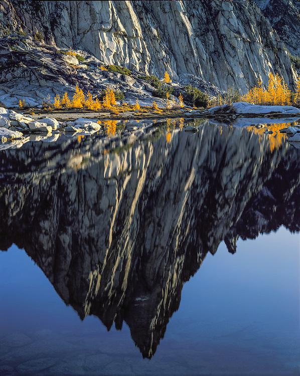 Reflection of Prusik Peak on Gnome Tarn, morning light, Alpine Lakes Wilderness, Wenatchee National Forest, Washington, USA