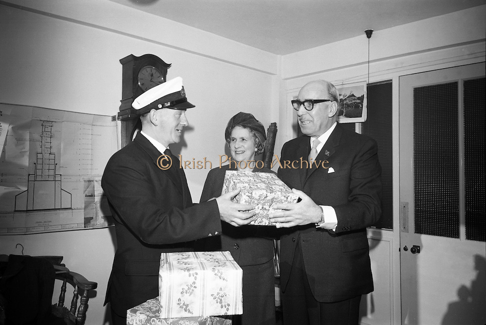 Helping to make their first Christmas on the new Kish Lighthouse a happy one, the Australian Ambassador, His Excellency the Hon. S. Robertson, handed over three plum puddings, a gift from the Dried Fruit Growers of Australia, to the men who will man the Lighthouse this Christmas..10.12.1965