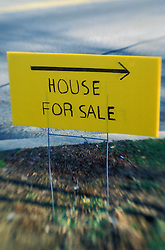yellow hand made house for sale sign in front yard. CONCEPT STOCK PHOTOS