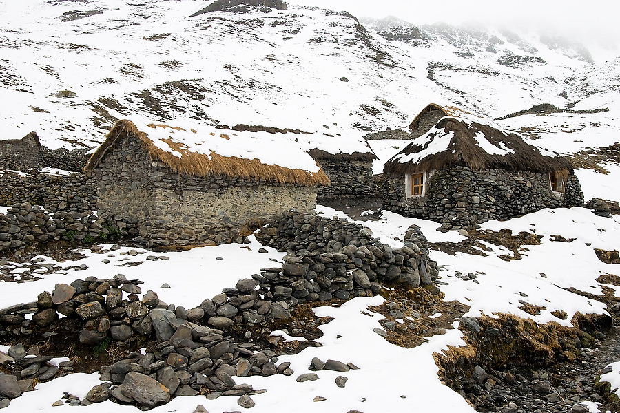 The alpaca herding village of the Q'eros people lies under freshly fallen snow high in the Cordillera de Paucartambo, Andes Mountains, Peru on September 14, 2005. The Q'eros, a Quecha people living in the Peruvian Andes, are considered the last direct descendants of the Incas and proudly maintain many of the ancient traditions.
