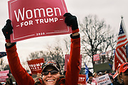 """06 DECEMBER 2020 - DES MOINES, IOWA: Supporters of Donald Trump cheer during a rally protesting the outcome of the US election. About 1,000 supporters of outgoing US President Donald Trump rallied in Des Moines Sunday to show their support for the President and to protest the outcome of the US Presidential election. They started with a rally in the suburbs of Des Moines then drove in a motorcade through the city, ending at the State Capitol. They repeated many of Trump's discredited claims that the election was marked by fraud and that Trump actually won. The protest was a part of the national """"March for Trump"""" effort, culminating in a march in Washington DC on December 13. Joe Biden won the election, with 306 electoral votes to Trump's 232.   PHOTO BY JACK KURTZ"""