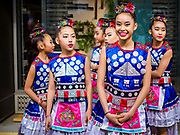 """29 APRIL 2017 - MINNEAPOLIS, MINNESOTA: Girls wait to perform in a Songkran talent show at Songkran Uptown. Several thousand people attended Songkran Uptown on Hennepin Ave in Minneapolis for the city's first celebration of Songkran, the traditional Thai New Year. Events included a Thai parade, a performance of the Ramakien (the Thai version of the Indian Ramayana), a """"Ladyboy"""" (drag queen) show, and Thai street food.     PHOTO BY JACK KURTZ"""
