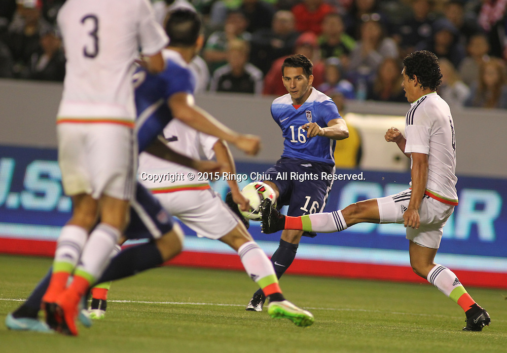 United States' Daniel Metzger #16 actions against Mexico during a men's national team international friendly match, April 22, 2015, at StubHub Center in Carson, California. United States won 3-0. (Photo by Ringo Chiu/PHOTOFORMULA.com)