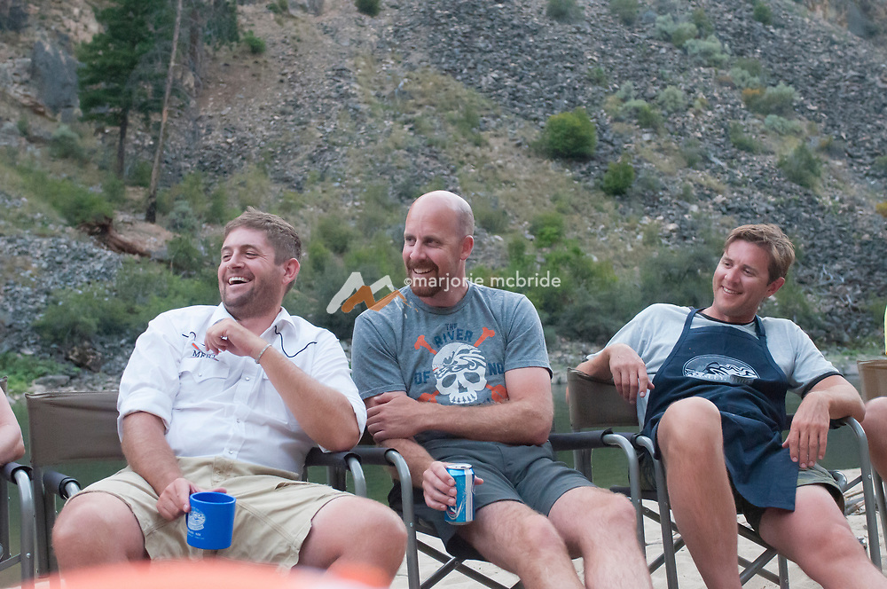 Enjoying live music at Otter Bar in The Impassible Canyon on the Middle Fork of the Salmon River during six day rafting vacation, Idaho.