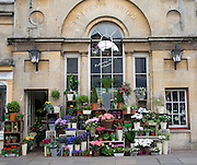 Flower shop Pulteney Bridge, Bath, England. Pulteney Bridge is one of only four bridges in the world to be lined with shops.