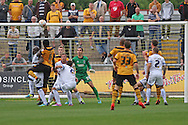 Ismail Yakubu of Newport county (6) heads to score his side's first goal. Skybet football league two match, Newport county v AFC Wimbledon at Rodney Parade in Newport, South Wales on Saturday 27th Sept 2014<br /> pic by Mark Hawkins, Andrew Orchard sports photography.